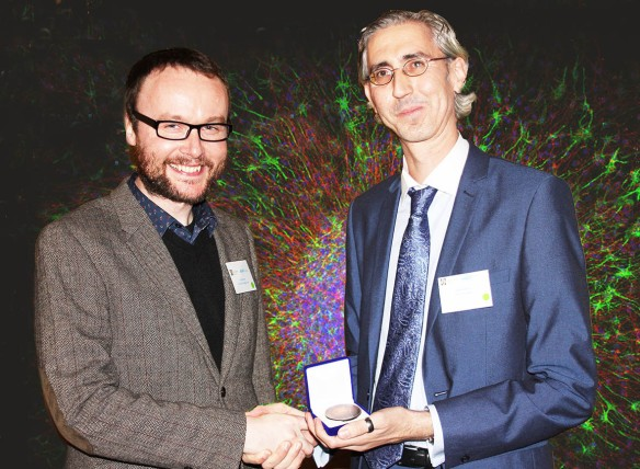 IMG_7528Eric Downer receiving Award from Richard Roche